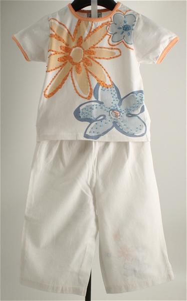 Immagine di Completo da bimba bianco/arancio/carta da zucchero